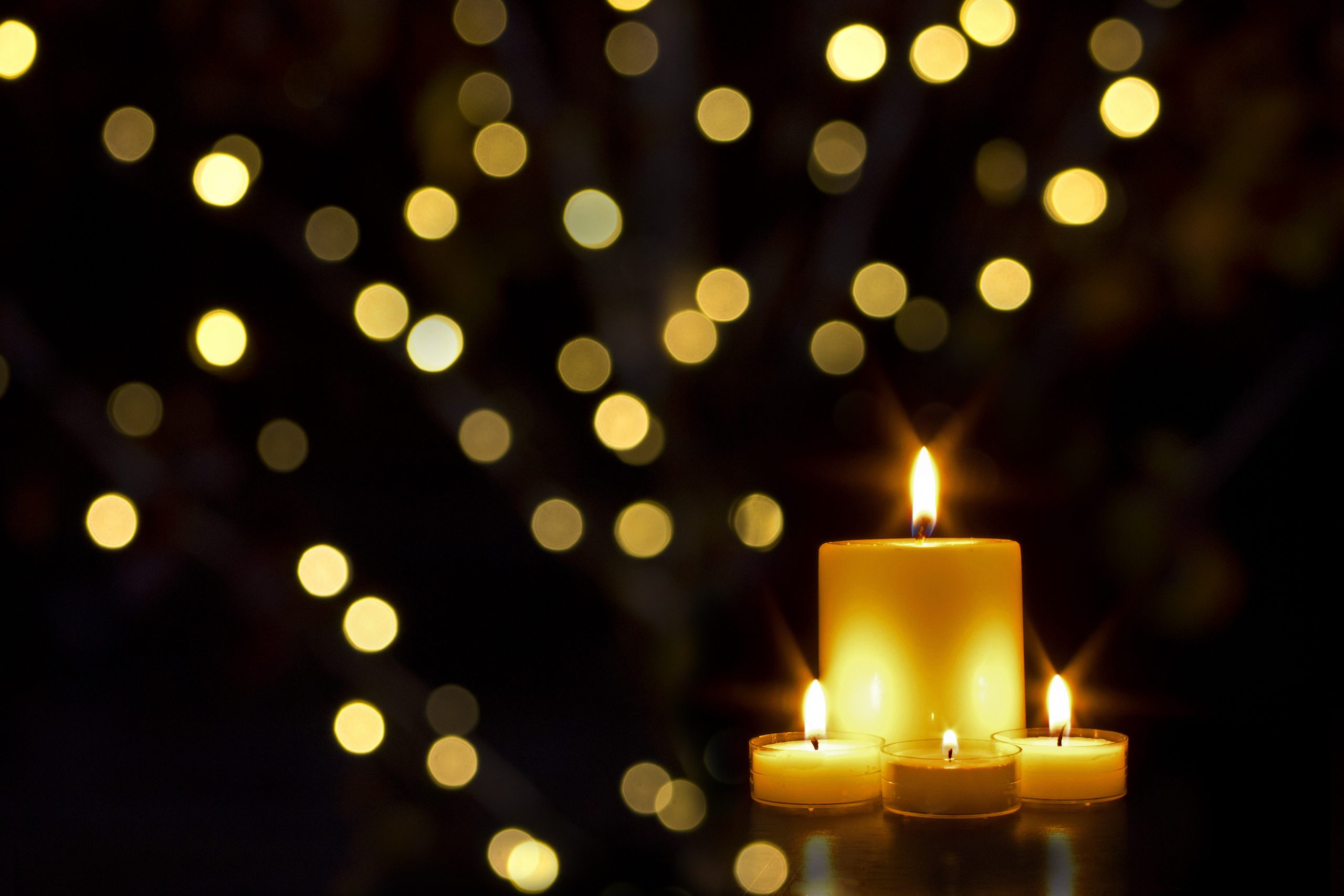 Stock image of regligious candles with gold light reflections